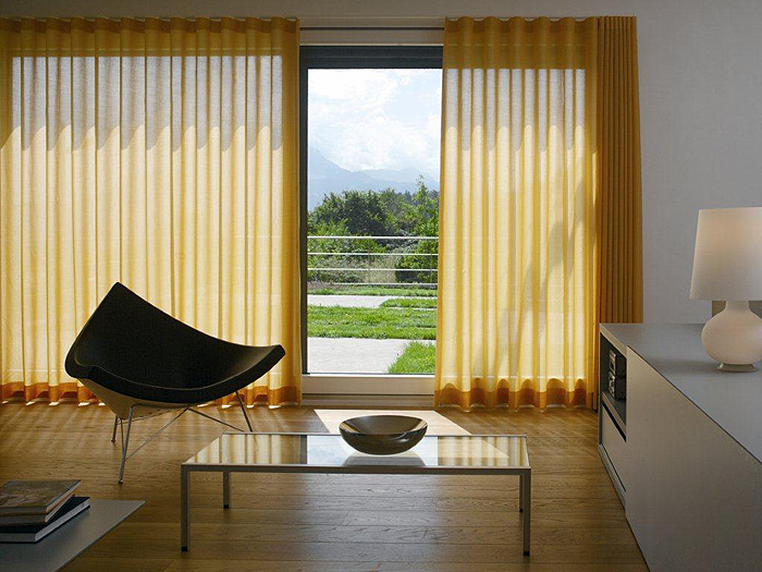 Yellow wave curtains in modern setting